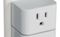 Photo of two Smart Plugs on Electrical Outlet
